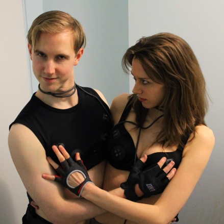 Silly Daniele and Kyle wearing PS1 controller bra and bro gamepads